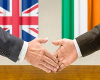 Representatives of the UK and Ireland shake hands