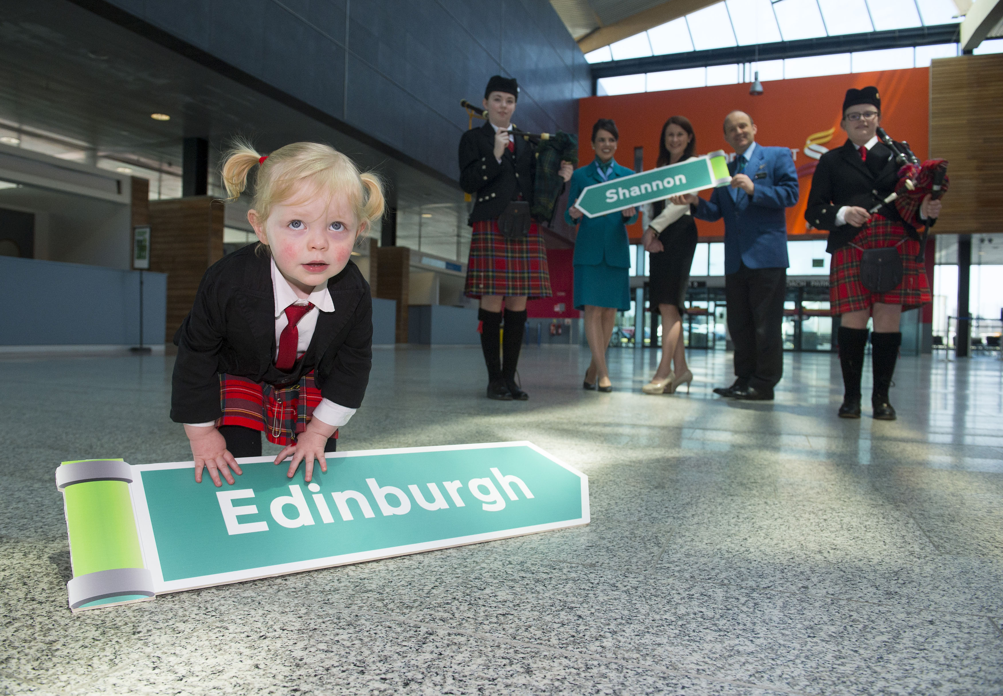 15/03/2016 REPRO FREE Pictured at the Aer Lingus Regional announcement of their Shannon to Edinburgh route are Aer Lingus Regional cabin crew Amy Scott, left, and Calvin Long, right, along with Shannon Group acting CEO Mary Considine and CBS Sexton Street Pipe Band members Niamh Hickey aged 15, left, Aoife McDarby aged 12, right, and Clodagh Purcell, aged 2. Picture credit: Diarmuid Greene/Fusionshooters -  Aer Lingus Regional will operate six flights per week – every day except Saturday. -  New route will add 35,000 seats for Shannon Airport in 2016, rising to 45,000 per annum from 2017. -  Edinburgh based customers can avail of transatlantic pre-clearance services in Shannon. -  Flights from €29.99 now available for booking on aerlingus.com. Aer Lingus Regional, operated by Stobart Air, today launched the first flight on its new route from Shannon to Edinburgh.  The new route will operate six times weekly with fares from €29.99 one-way including taxes and charges. It will result in an additional 35,000 seats for Shannon Airport in 2016, rising to 45,000 per annum from 2017. Edinburgh passengers flying to Shannon will be able to take advantage of Aer Lingus's transatlantic services to New York and Boston.  Shannon Airport offers U.S. bound passengers immigration and customs preclearance services, meaning that there are no border checks upon arrival in the United States, thereby avoiding potentially long queuing times.  Flights are available for booking on aerlingus.com.