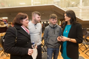 Anne Marie, George and Dylan Bull chatting to Helen Downes at the Shannon Chamber of Commerce Apprenticeships Information Evening in St. Patrick's Comprehensive School in Shannon. Photograph by Eamon Ward