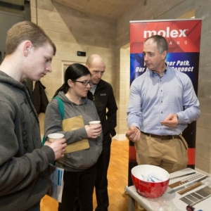 Keith O'Loughlin, Anne Marie Fleming and Raymond O'Loughlin chatting to Michael Collins at the Molex stand during the Shannon Chamber of Commerce Apprenticeships Information Evening in St. Patrick's Comprehensive School in Shannon. Photograph by Eamon Ward