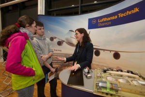 Mary Gleeson and James Leigh, Ennistymon chatting to Grace at the Lufthansa Technik stand at the Shannon Chamber of Commerce Apprenticeships Information Evening in St. Patrick's Comprehensive School in Shannon. Photograph by Eamon Ward