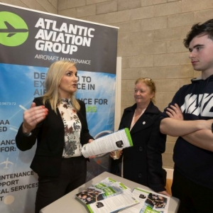 Fiona Donlon , Atlantic Aviation chatting to Triona and Donal McNamara , Ballyea at the Shannon Chamber of Commerce Apprenticeships Information Evening in St. Patrick's Comprehensive School in Shannon. Photograph by Eamon Ward